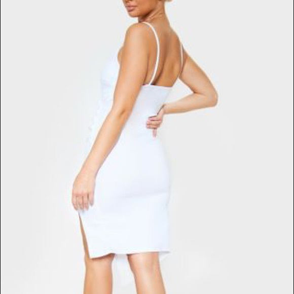 Lauriell White Wrap Dress from Prettylittlething